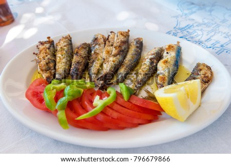 Seafood, grilled sardines served in traditional Greek tavern. Naxos island. Greece.