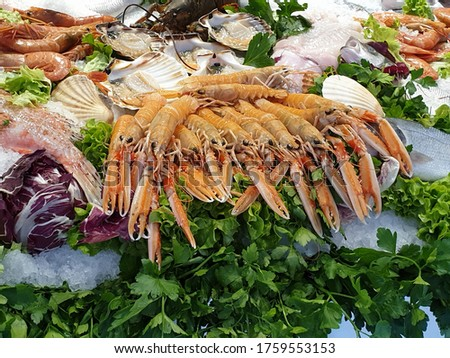 Seafood is any form of sea life regarded as food by humans, prominently including fish and shellfish. Shellfish include various species of molluscs, crustaceans, and echinoderms.