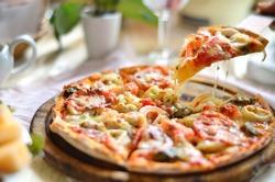 Seafood Italian Pizza slice on wood dish (originality)