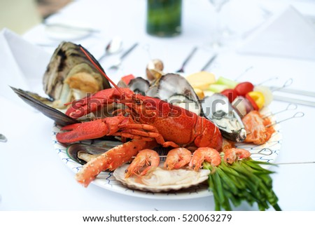 Seafood Lobster dinner on table during wedding ceremony