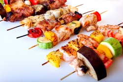 seafood meat bacon grilled vegetables on wooden skewers