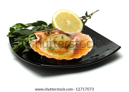 Seafood on black dish isolated over white