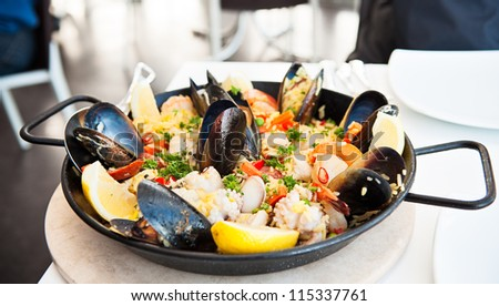 Seafood paella pan on a restaurant table