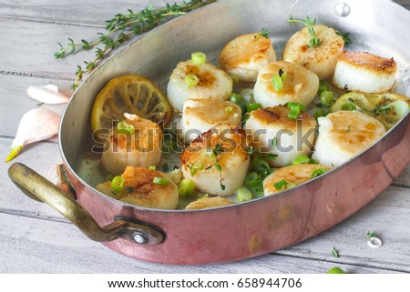 Seafood: pan-seared scallops with lemon and herbs