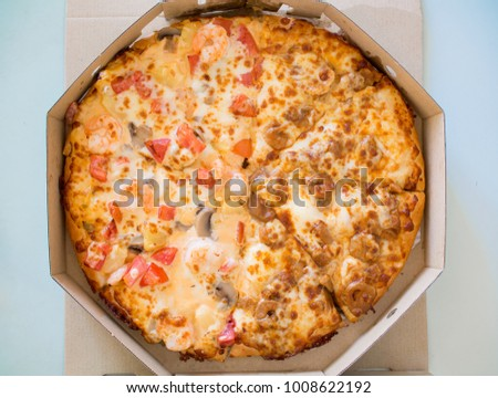 Seafood pizza in box. Delivery pizza. #1008622192