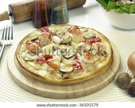 seafood pizza on a wooden plate