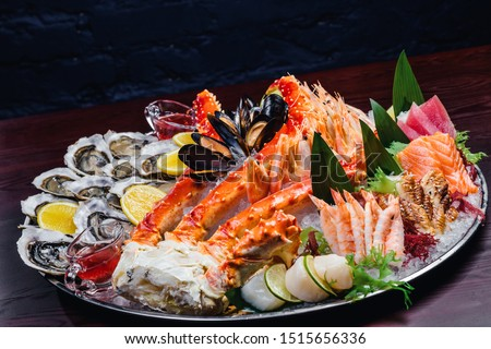 Seafood platter. Seafood on a large plate. Assorted seafood from mussels, oysters, crab, shrimp