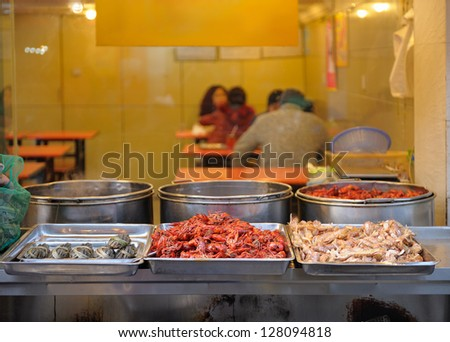 Seafood restaurant in China, Shanghai. Outdoor kitchen . Evening time