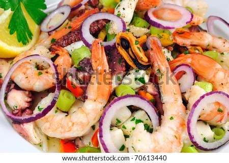 Seafood Salad Salad with prawns, mussels, squids, onions and spring onions decorated by lemon and parsley.