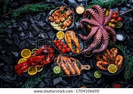 Seafood, seafood on coal, background seafood, lobster, octopus, shrimps, scampi