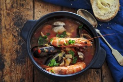 Seafood soup with prawns, mussels and clams