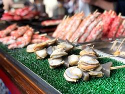 Seafood Street food in Tsukiji Fish Market, Japan.