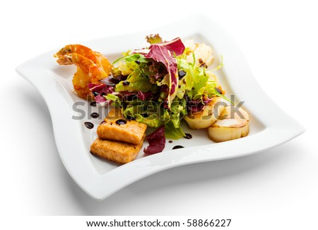 Seafoods - Shrimps, Sea Scallops, Squids and Salmon. Garnished with Fresh Raw Salad Leaf.