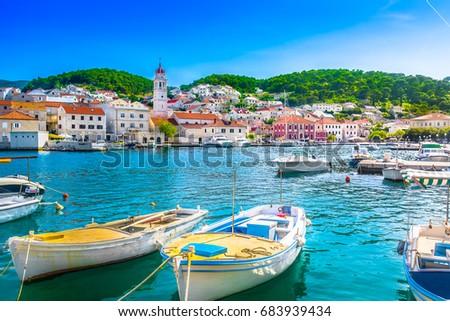 Seafront scenery of small mediterranean village Pucisca on Island Brac, tourist summer resort in Croatia, Europe. / Selective focus.