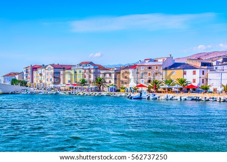 Seafront view at coastal scenic promenade in town Pag, popular touristic destination on Adriatic Coast, Croatia Europe. #562737250
