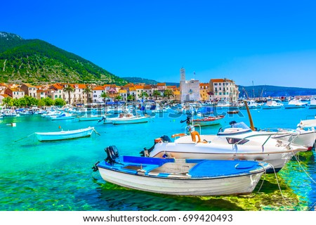 Seafront view at coastal town Komiza on Island Vis, summer travel resort in Croatia, Mediterranean. #699420493