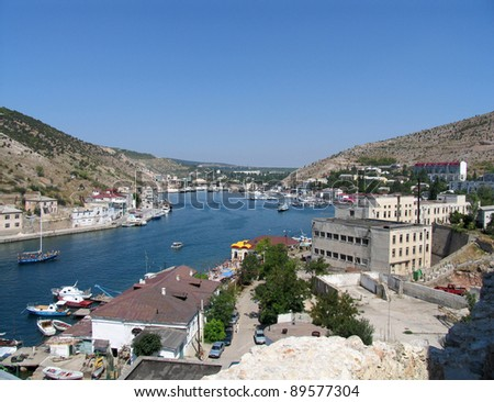 seafront with ships at pier Balaclava Town, Crimea, Ukraine - stock photo