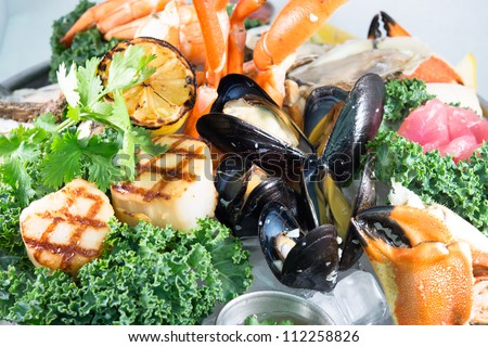 Seagood Platter: A close-up of a beautiful gourmet seafood platter with a variety of shellfish, crustaceans and fish
