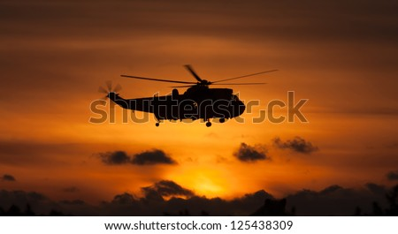 Seaking helicopter in the sunset from RAF Valley Search and Rescue flight