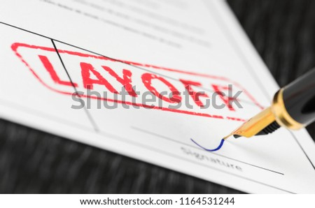 Seal layoff stamped on a document and fountain pen. Macro shot. Soft focus. Stockfoto ©