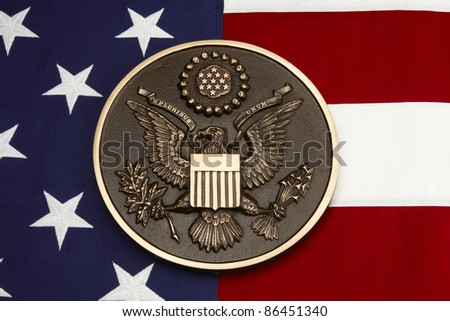 Seal of the United States shot on American flag close up