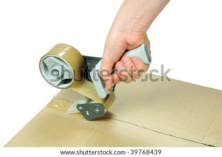 sealing cardboard box with adhesive packing tape - stock photo