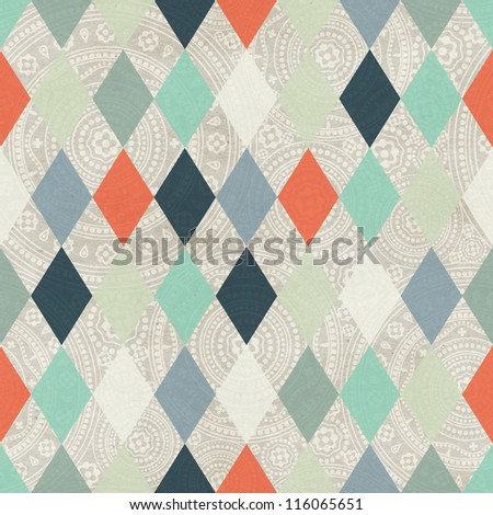Seamless argyle based winter pattern on paper texture