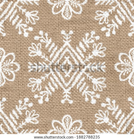 Seamless burlap with white paint pattern overlay. High quality illustration. Real burlap fabric texture with digital pattern on top for print in various surface design uses. Great for interiors.
