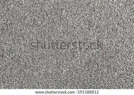 Seamless close up of monochrome grey carpet texture background from above.