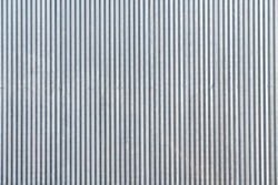 Seamless corrugated zinc sheet facade in gray color / architecture / seamless pattern / wallpaper concept / metal texture