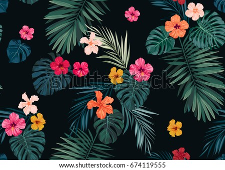 Seamless hand drawn tropical pattern with bright hibiscus flowers and exotic palm leaves on dark background.