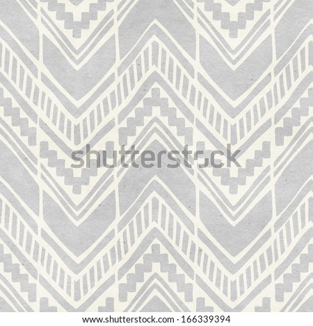 Seamless ikat pattern on paper texture. Subtle tribal background