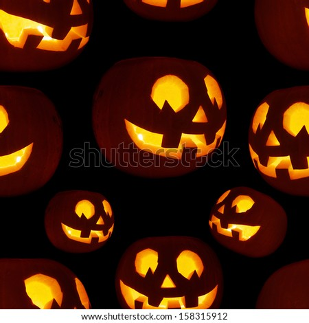 Seamless Jack-o'-lanterns pumpkin texture pattern as a Halloween background