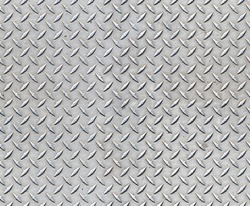 Seamless metal floor plate with diamond pattern.