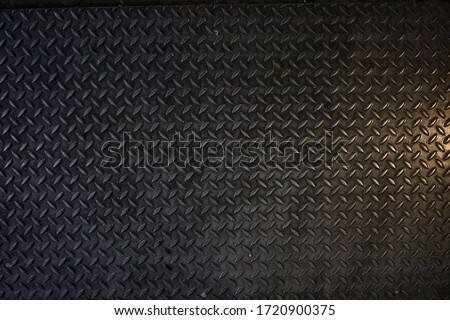 Seamless Metal Floor Plate With Diamond Pattern.Black metal background or black steel surface stock photo