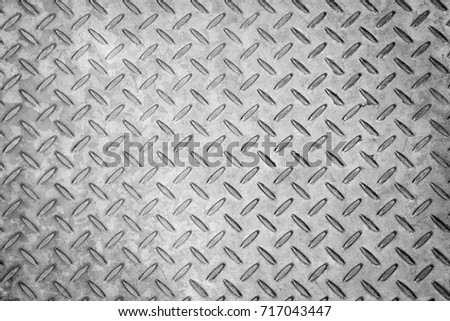 seamless metal texture background, aluminium or stainless dark list with rhombus shapes #717043447