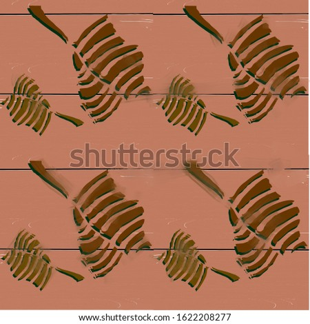 Seamless pattern exotic with exotic prints of dried leaves on a wooden board