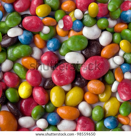 Seamless pattern from a photo of multicolored sweets - stock photo