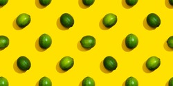 Seamless pattern from limes on a yellow background.