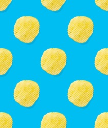 Seamless pattern made from Potato chips on light blue background flat lay. potato snack chips isolated Fast food banner.