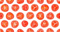 Seamless pattern made of tomato slices. Flat lay, top view. Food concept. Vegetables isolated on white background. Food ingredients pattern.