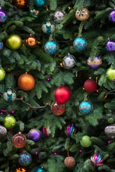 Seamless pattern of Christmas tree branchrs with balls. Close up