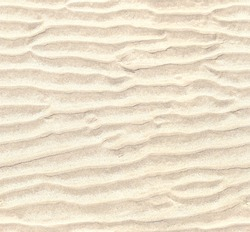 Seamless pattern of empty sand background. Repeating texture of waves on white sandy beach