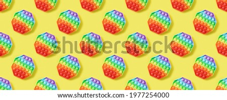 Seamless pattern of popular silicone colorful anti stress pop it toy for child on yellow background. Push Pop Bubble. Banner. Simple dimple