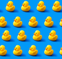 Seamless pattern rubber ducks  on a blue background