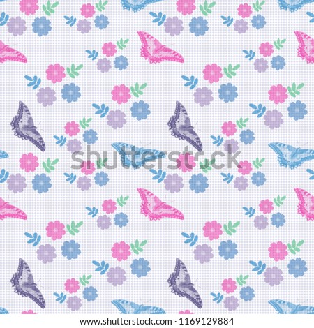 Seamless pattern with a floral pattern and butterflies in pastel colors.