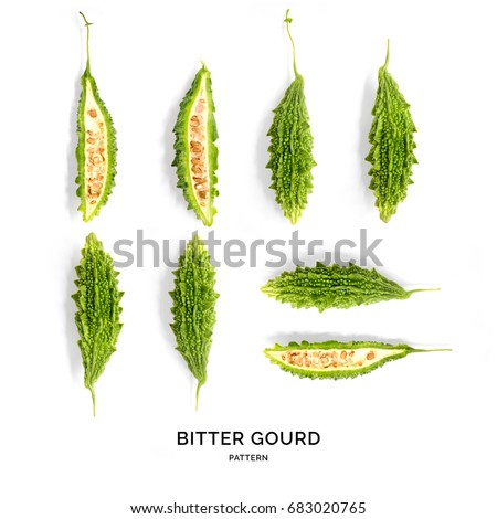 Shutterstock Seamless pattern with  bitter gourd. Tropical abstract background. Bitter gourd on the white background.