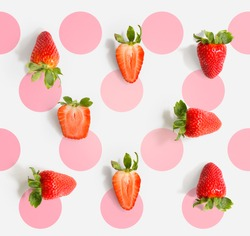 Seamless pattern with strawberry. Tropical abstract background. Strawberry on the light background with pink dots.
