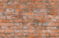 Seamless red brick pattern. Old brick wall with cracks and scratches. Horizontal wide brickwall background. Distressed wall with broken bricks texture. Vintage house facade.