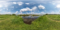 seamless spherical hdri panorama 360 degrees angle view on grass coast of huge lake or river in sunny summer day and windy weather with beautiful clouds in equirectangular projection, VR content